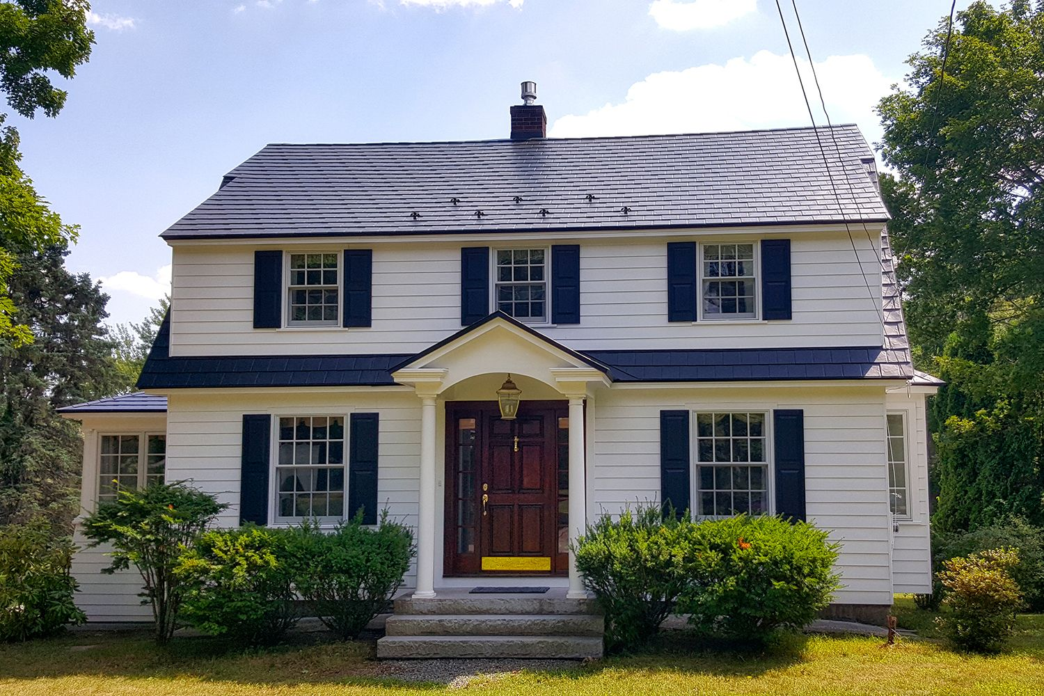 black metal slate roof colonial gambrel house