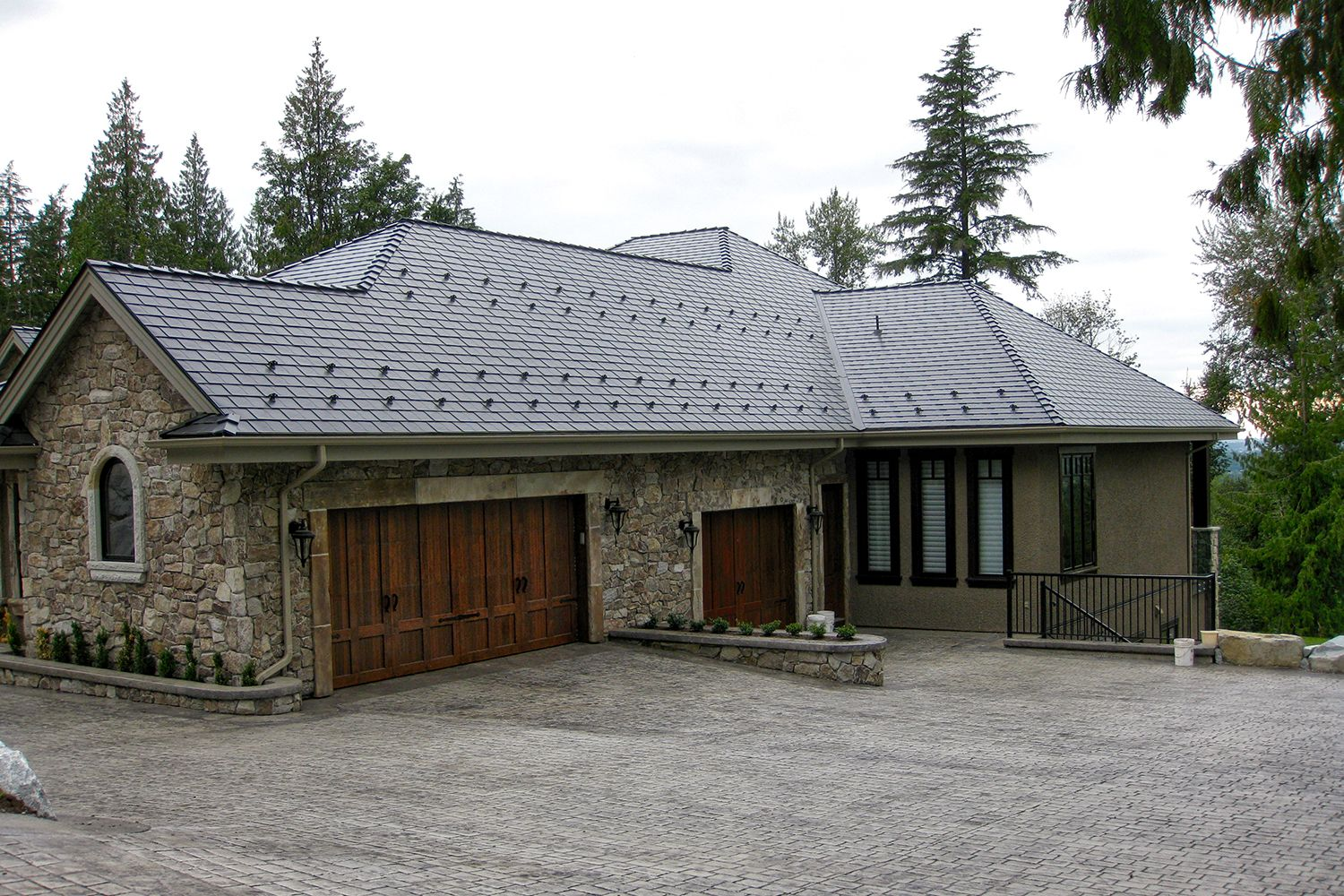 deep charcoal metal slate roof snow guards stone rustic